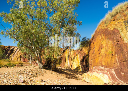 Multicoloured Ochre Pits in the West MacDonnell Ranges near Alice Springs in the Red Centre of outback Central Australia - Stock Photo