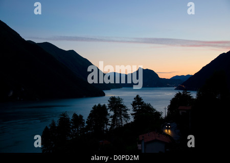 Evening light over Lake Lugano near Porlezza - Stock Photo