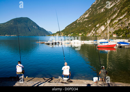 Men fishing on Lake Lugano at Porlezza - Stock Photo