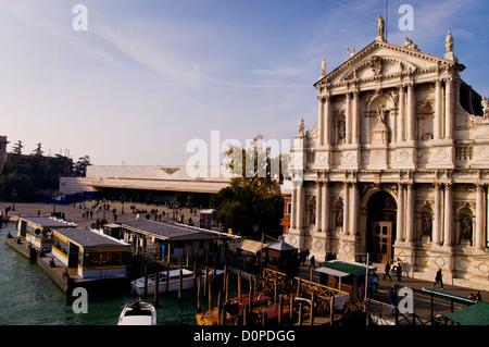 Stazione Ferroviaria Santa Lucia left and Santa Maria in Nazareth degli Scalzi chuch right on the Grand Canal - Stock Photo