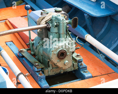 old perkins diesel engine on the wooden boat - Stock Photo