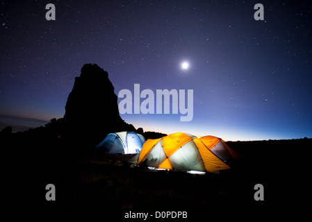 MT KILIMANJARO, Tanzania - Tents at the Lava Tower Camp at night, with clear stars. The rock formation at left is - Stock Photo