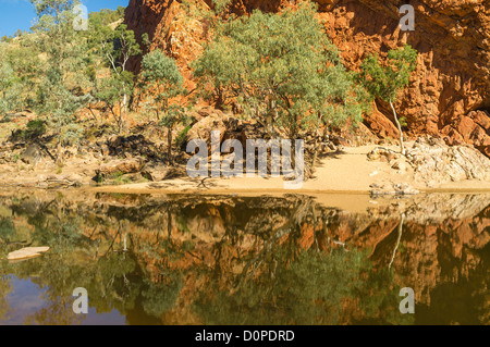 Red walls of Ormiston Gorge reflected in waterhole, West Macdonnell Ranges Ranges, Alice Springs, the Red Centre - Stock Photo