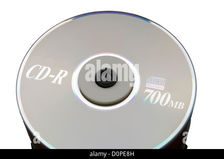 Stack of 700mb CD-R Discs against a red background - Stock Photo