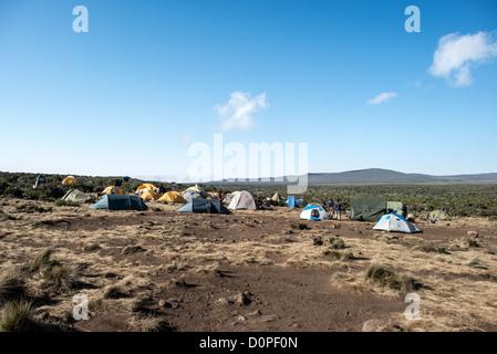 MT KILIMANJARO, Tanzania - Tents laid out at Shira 1 camp on Mt Kilimanjaro. - Stock Photo