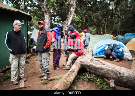 MT KILIMANJARO, Tanzania - Relaxing at Big Tree Camp (formally known as Forest Camp) on the first night of a climb - Stock Photo