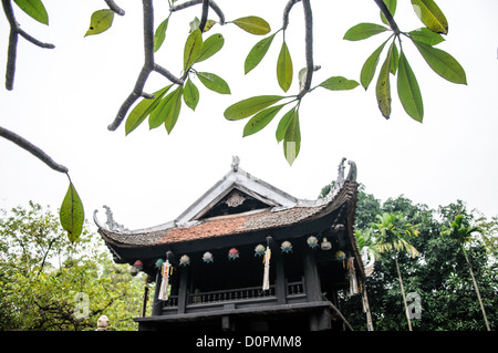 HANOI, Vietnam - The historic, small One Pillar Pagoda sits in the center of a small pond near the Ho Chi Minh Museum - Stock Photo