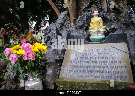 HANOI, Vietnam - A small shrone sits in a gnarled old tree next to the One Pillar Pagoda. The historic, small One - Stock Photo