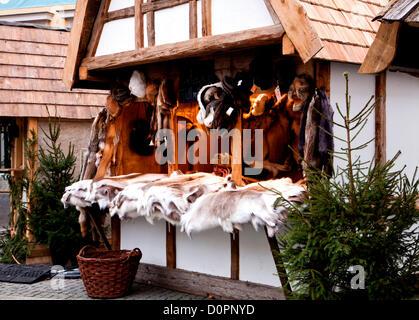 Munich, Germany . Traditional Medieval Christmas market ( Mittelaltermarkt) at Wittelsbacher Platz in Munich.Vendor - Stock Photo