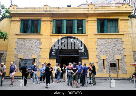 HANOI, Vietnam - Tourists standing on the sidewalk in front of the main entrance to Hoa Lo Prison museum. Hoa Lo - Stock Photo