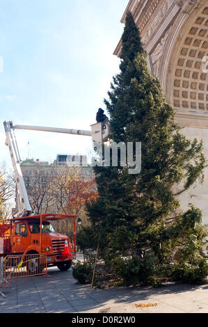 New York, NY -  29 November 2012 Parks workers use a cherry picker to trim 45 foot Spruce in preparation of the - Stock Photo