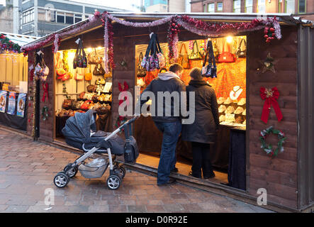 Customers and stall holders at the Christmas Market held from late November until Christmas in St Enoch Square in - Stock Photo