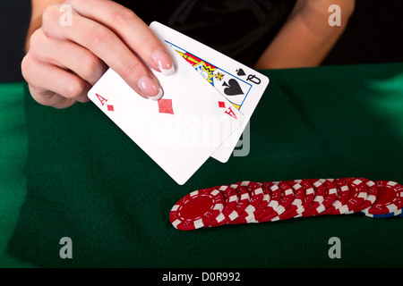 Gambler with cards and chips. - Stock Photo