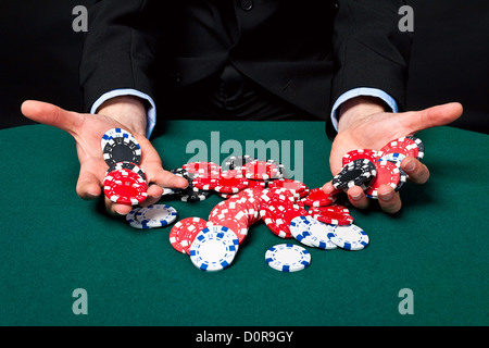 Gambler with chips in hand. - Stock Photo