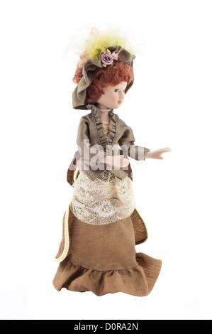 beautiful retro porcelain doll on a white background - Stock Photo