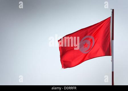 Tunisian flag waving in the wind - Stock Photo