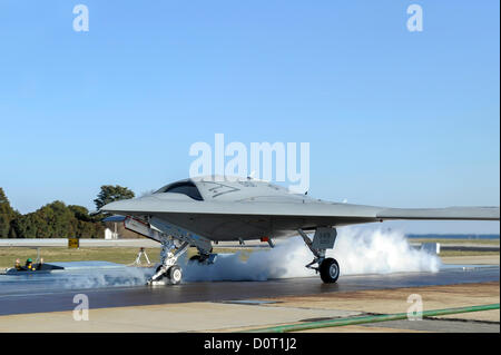 Launch crews watch the X-47B Unmanned Combat Air System aircraft begin the first land-based catapult launch test - Stock Photo
