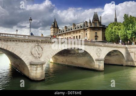 The bridge Pont au Change over river Seine in Paris, France. - Stock Photo