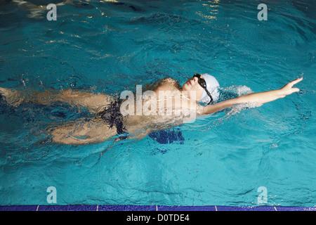 Boy swimming back stroke - Stock Photo
