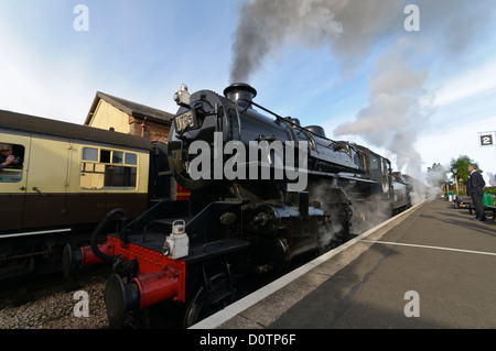 Ivatt class 4 number 43106 Steam Locomotive on the West Somerset Railway pulling away from Williton station. - Stock Photo