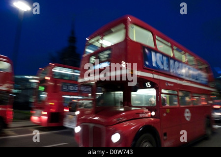 Number 15 bus at night near St. Paul's Cathedral Cheapside London England UK - Stock Photo
