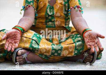 Pretty young Indian girl dressed up showing henna hands. Andhra Pradesh, India - Stock Photo