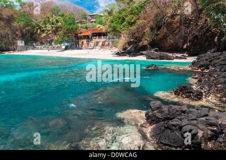 Small hotell on tropical beach. Padangbai, Bali, Indonesia. - Stock Photo