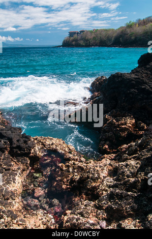 Rocks on tropical beach. Padangbai, Bali, Indonesia. - Stock Photo