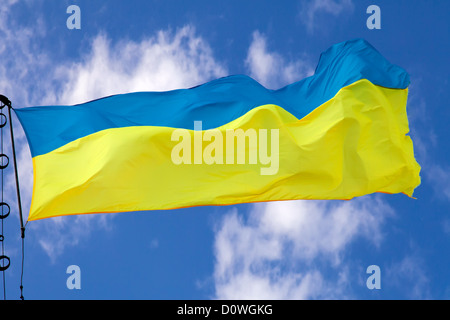 Ukrainian flag waving on cloudy sky - Stock Photo