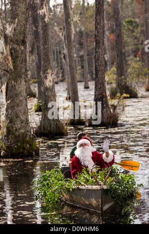 Charleston, USA. 1st December 2012. Santa Claus arrives by swamp boat at Cypress Gardens Swamp December 1, 2012 - Stock Photo