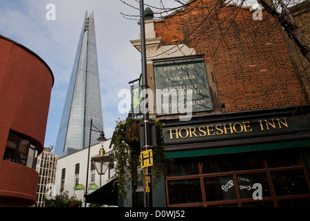VIEW OF THE SHARD TOWER IN LONDON, THE TALLEST BUILDING IN UK,  AND SURROUNDINGS IN BERMONDSEY, SOUTHWARK BOROUGH - Stock Photo