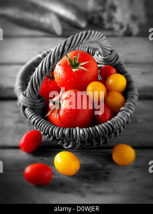 Mixed red and yellow tomatoes photos, pictures & images - Stock Photo