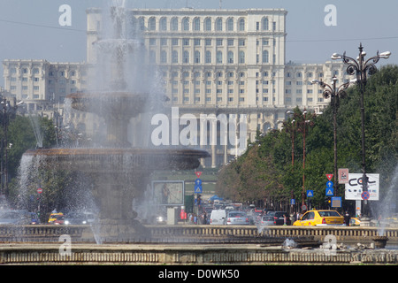 Bucharest, Romania, the fountain at the Unity Square and Palace of the Parliament - Stock Photo