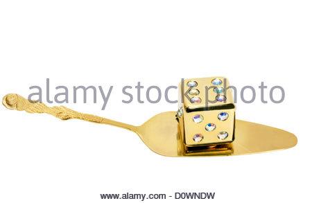 dice on golden spoon - Stock Photo