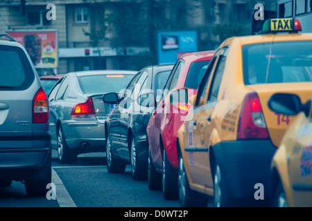 BUCHAREST, ROMANIA - October 2, 2012: Cars during rush hour in downtown Bucharest - Stock Photo