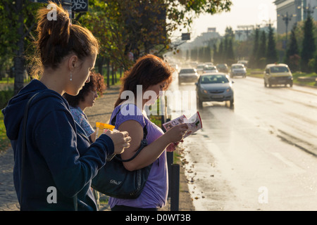 BUCHAREST, ROMANIA - September 29, 2012: People waiting to cross the Bulevardul Unirii in downtown Bucharest. - Stock Photo