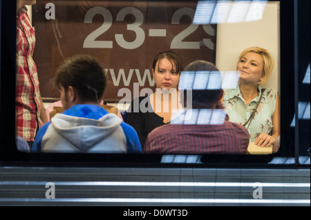 BUCHAREST, ROMANIA - October 1, 2012: People in subway system in Bucharest - Stock Photo