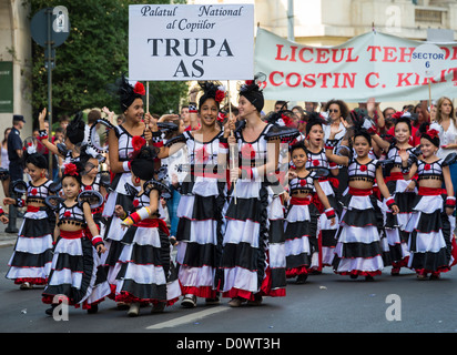 BUCHAREST, ROMANIA - September 29, 2012: Students walking in Bucharest during a parade and celebration - Stock Photo