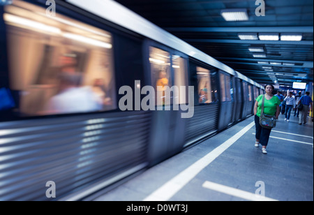 BUCHAREST, ROMANIA - October 1, 2012: Woman walking in a subway station in Bucharest - Stock Photo