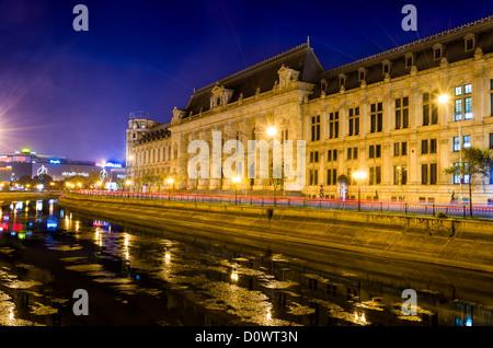 BUCHAREST, ROMANIA - OCTOBER 1 2012: Night view of The Palace of Justice ((Romanian: Palatul Justiţiei) located - Stock Photo