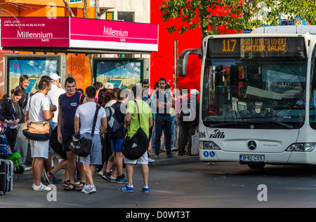 BUCHAREST, ROMANIA - September 29, 2012: People waiting the bus in downtown Bucharest. - Stock Photo