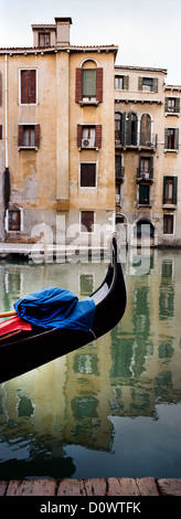A Gondola tied up in the canal ways of Venice near Piazza San Marco. Venice, Italy. - Stock Photo