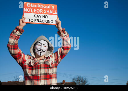 Man wearing anonymous face mask ; 'Guy Fawkes masks' _  Protesters against a UK 'Dash to Gas' and fracking for shale - Stock Photo