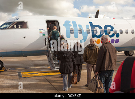 Passengers getting onto a Flybe plane at Bristol airport, England, UK - Stock Photo