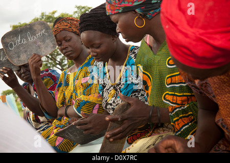 Women learn reading and writing in an adult education class in Doba, Chad, Africa. - Stock Photo