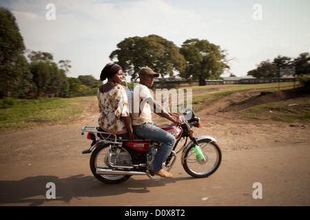 Motorcycle taxi (boda boda) in Kasese, Uganda, East Africa - Stock Photo