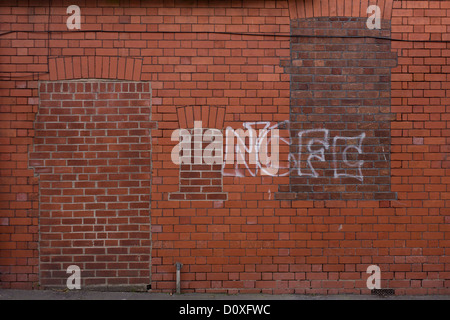 A bricked-up doorway and windows with football graffiti in a vacant retail building during & Wall with bricks doorway filled in with bricks creative Stock ... Pezcame.Com