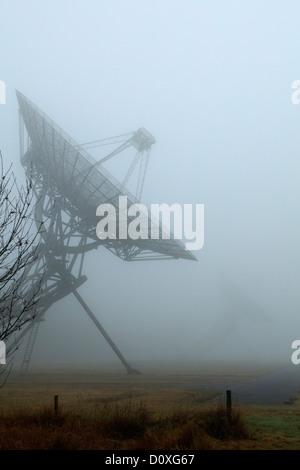 Radio Telescopes in the fog - Stock Photo