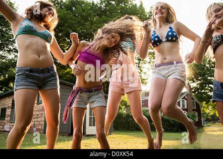 Girls dancing in garden - Stock Photo