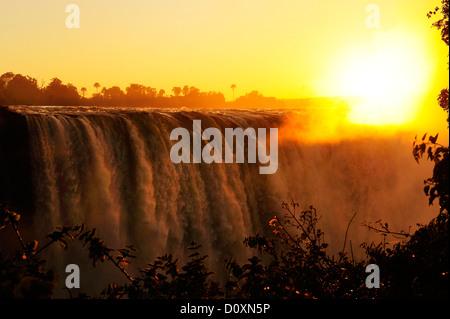 Africa, Zimbabwe, Zambezi, River, Southern Africa, Victoria Falls, waterfall, water, canyon, gorge, sun, sunset - Stock Photo